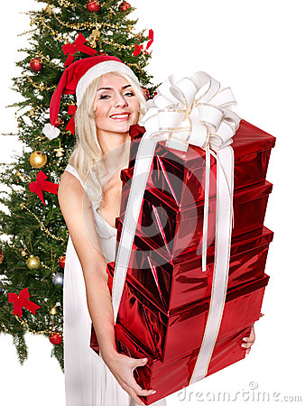 Free Christmas Girl In Santa Hat Giving Red Gift Box. Royalty Free Stock Photo - 35353495