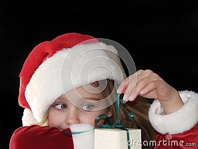 Christmas girl opening gift