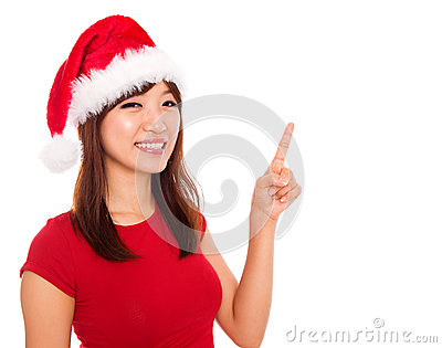 Christmas girl pointing on blank space