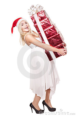 Christmas girl in santa hat holding  gift box.