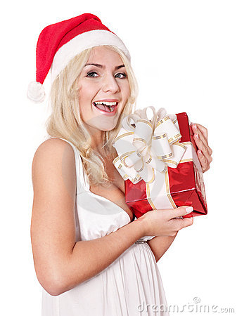 Christmas girl in santa hat holding red gift box.