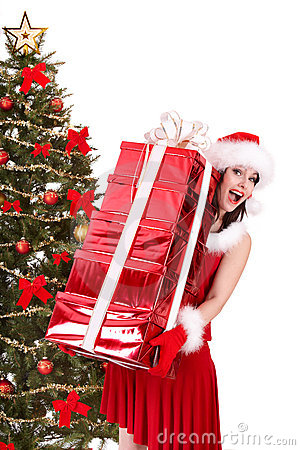 Christmas girl in santa hat and  red gift box.