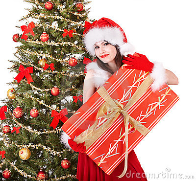 Christmas girl in santa holding gift box.