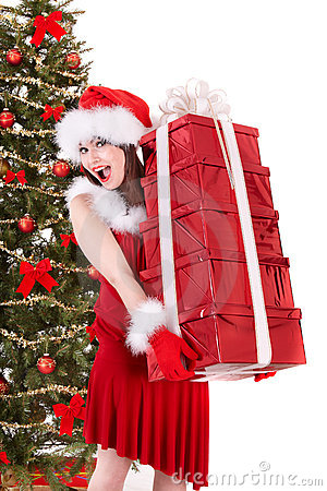 Christmas girl in santa holding stack gift box.