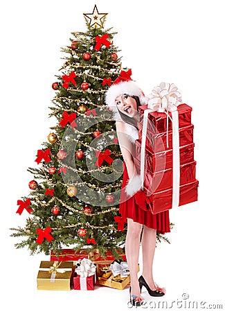 Christmas girl in santa holding stack gift box.