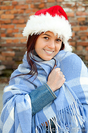 Christmas girl wrapped in blue blanket