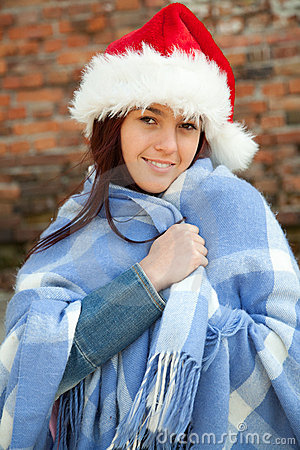 Christmas girl wrapped in blue blanket, outdoors