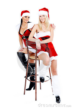 Christmas girls sitting on th stool