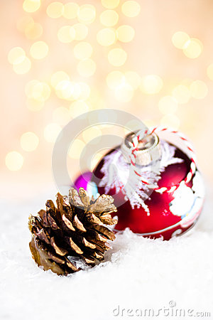 Christmas  glowing  bauble on a white snow with abstract christm
