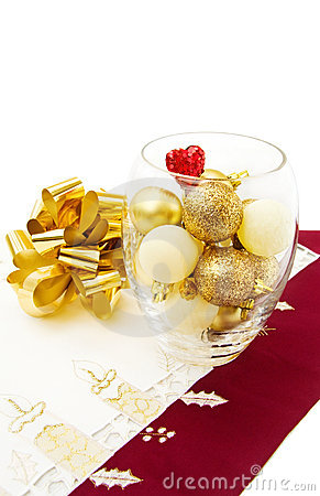 Christmas golden baubles and festive bow