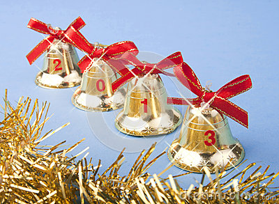 Christmas golden bells and red ribbon