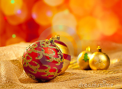 Christmas golden and red baubles in blur lights