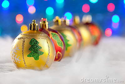 Christmas golden red baubles in a row with lights