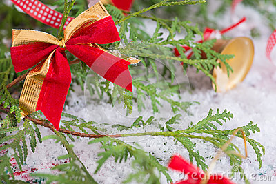 Christmas golden red bow decoration on tree