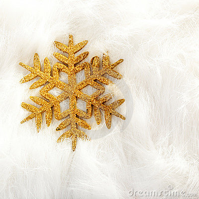 Christmas golden snowflake over white fur