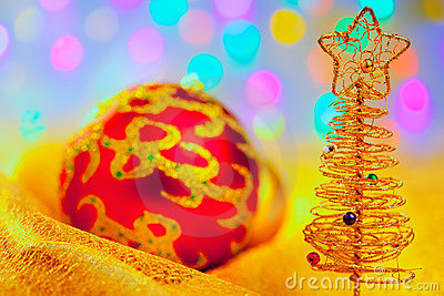 Christmas golden tree with baubles and lights