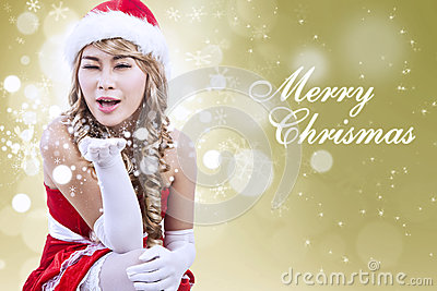 Christmas greeting by Santa woman in golden lights