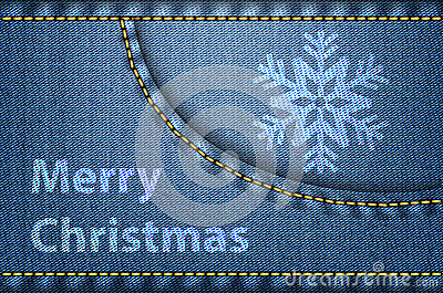 Christmas greetings on blue jeans background
