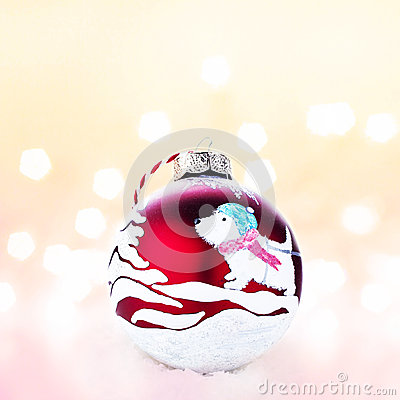 Christmas  handmade red ball on a white snow with abstract chris