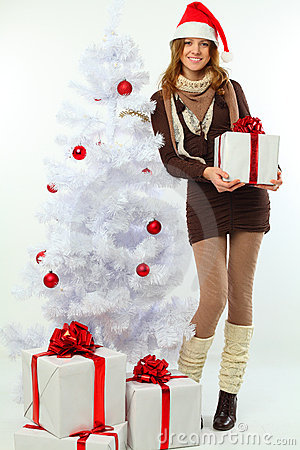 Christmas - happy girl with gift and snow fir