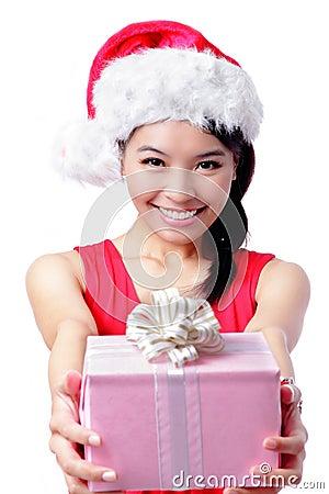 Christmas happy girl holding gift
