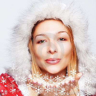 Free Christmas - Happy Woman Blowing Snow Flakes Royalty Free Stock Photos - 11880718
