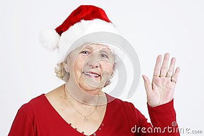 Christmas hat grandma waving hello