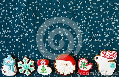 Christmas homemade gingerbread man and christmas tree cookies on green placemat. Traditional cookies with icing Stock Photo