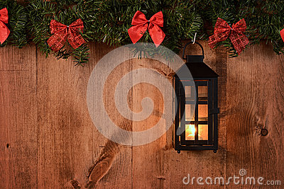 Christmas lantern with pine boughs and bows