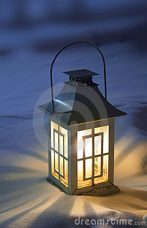 Christmas lantern on snow