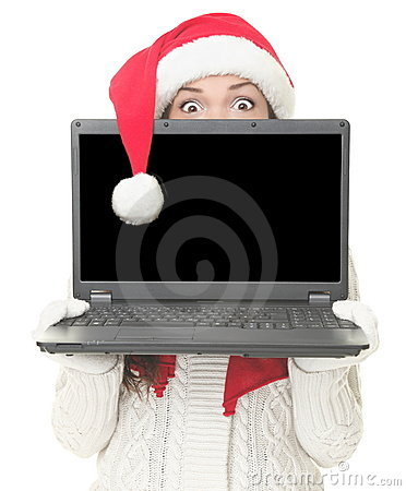 Christmas laptop woman surprised
