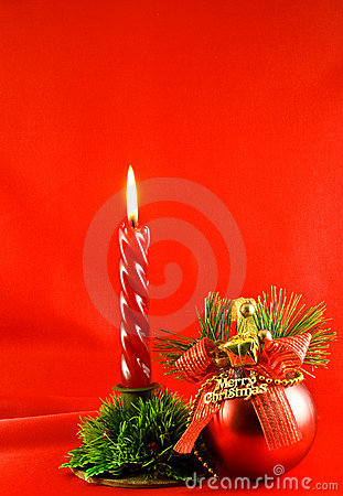 Christmas lighting candle and red ball