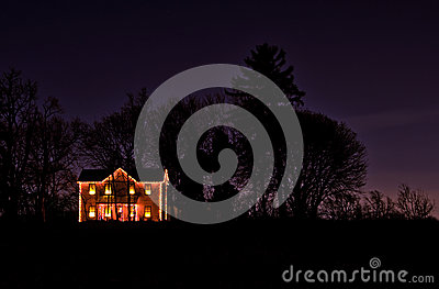 Christmas lights on a lone rural farmhouse