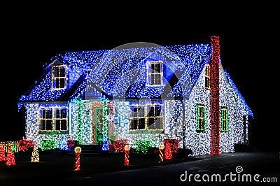 Christmas Lights Show Display on House at Night