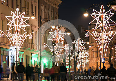 Christmas lights on street with people