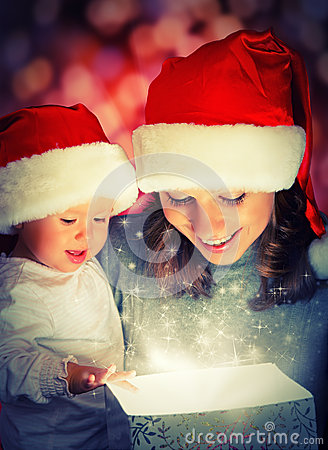 Free Christmas Magic Gift Box And A Happy Family Mother And Baby Royalty Free Stock Photos - 33374058
