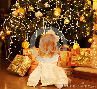 Christmas, magic, people concept - happy baby dreams