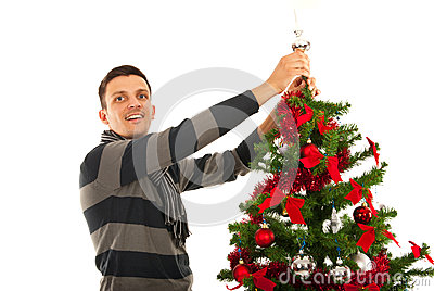 Christmas man  decorate tree