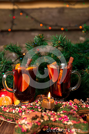 Free Christmas Mulled Wine With Fruits And Spices On Wooden Table. Xmas Decorations In Background. Two Glasses. Winter Warming Drink  R Royalty Free Stock Image - 80946876