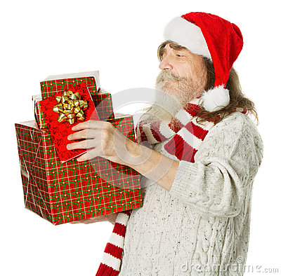 Christmas old man with beard in red hat carrying present box