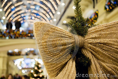 Christmas ornament in form of bow on fir-tree