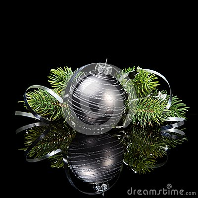 Christmas ornament with pine tree branches on a bl