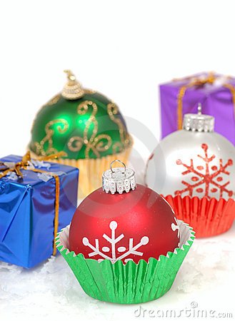 Christmas ornaments in cupcake liners with gifts