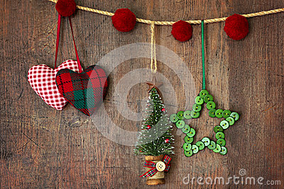 Christmas ornaments hanging on wood