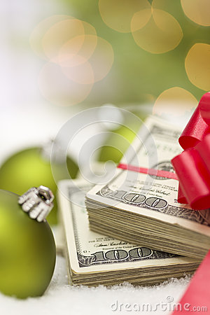 Christmas Ornaments and Stack of Hundred Dollar Bills with Bow