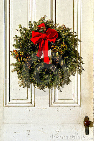 Christmas Pine Wreath with Red Bow on Antique Door