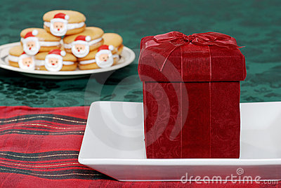 Christmas present on plate with cookies background