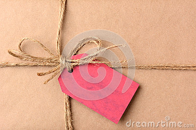 Christmas Present With Red Gift Tag Closeup