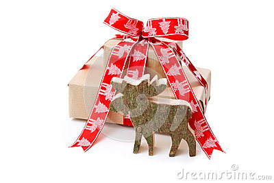 Christmas present in red with a wooden handmade elk or reindeer