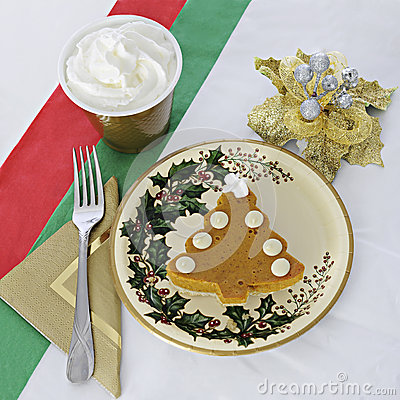 pie shaped like a Christmas tree on holiday plate and a red, white ...